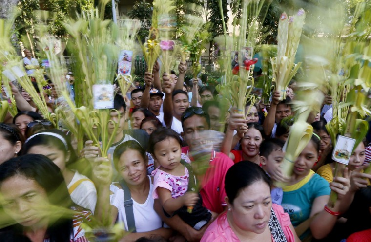 Roman Catholic devotees wave palm fronds to be blessed by a priest to commemorate Palm Sunday which marks the beginning of Holy Week Sunday, March 20, 2016 at the Redemptorist Church in Baclaran, south of Manila, Philippines. Palm Sunday, which is the final week of Lent, marks the triumphant entry of Jesus Christ into Jerusalem. The palm fronds end up in homes of devotees for a year, to be burned after and its ashes to be used for Ash Wednesday for next Season of Lent. (AP Photo/Bullit Marquez)