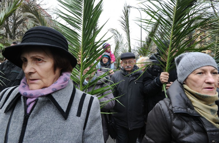 People carry palm leaves during a Palm Sunday procession in Warsaw, Poland, Sunday, March 20, 2016. Palm Sunday opens the Holy Week that ends with Easter Sunday, the most important Catholic holiday. (AP Photo/Alik Keplicz)