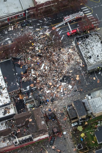 An aerial view of damage from a natural gas explosion that flattened buildings in Seattle Wednesday morning, March 9, 2016. Crews were responding to reports of a natural gas leak when the explosion occurred along a main thoroughfare just north of downtown, Seattle Fire Department spokeswoman Corey Orvold said. (Steve Ringman/The Seattle Times via AP)