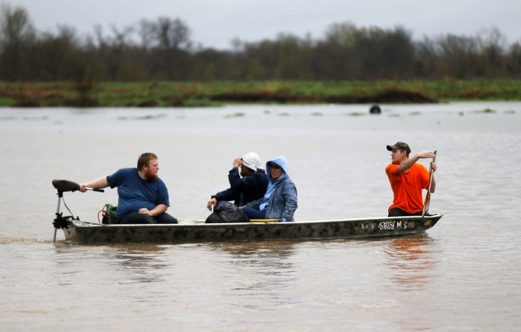 Residents are evacuated by boat through rising floodwaters in Bossier Parish, La., Thursday, March 10, 2016. (AP Photo/Gerald Herbert)