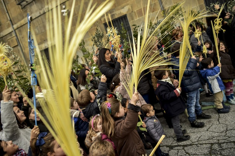 Children take part in the procession during Palm Sunday, prior to Holy Week, leading up to Easter, in Pamplona northern Spain, Sunday, March 20, 2016. (AP Photo/Alvaro Barrientos)