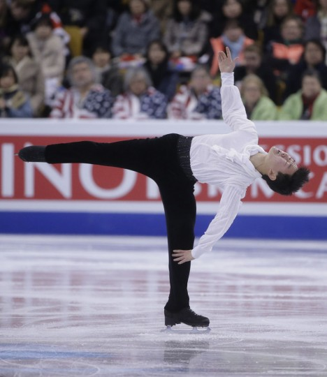 Denis Ten, of Kazakhstan, spins during the men's short program in the World Figure Skating Championships Wednesday, March 30, 2016, in Boston. (AP Photo/Steven Senne)