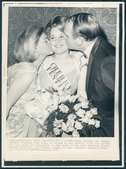 """Carol Burton, the Cherry Blossom Princess from Utah, is kissed by her parents last night after her selection as the Queen of the 1969 National Cherry Blossom Festival. Her father, right, is Rep. Laurence Burton, R-Utah. "" April 13, 1969."