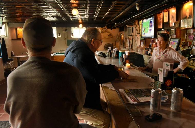 Mike Tuite, center, who lives in the neighborhood, chats with barmaid Mari Wick in the mid-afternoon while nursing a Coors Light draft. (Amy Davis/Baltimore Sun)