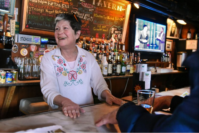 "Barmaid Mari Wick has worked at the Venice Tavern off and on since the 1970's. She has worked there steadily since 2014. Wick observed, ""We don't need to have Happy Hours. These are our every day prices."" (Amy Davis/Baltimore Sun)"