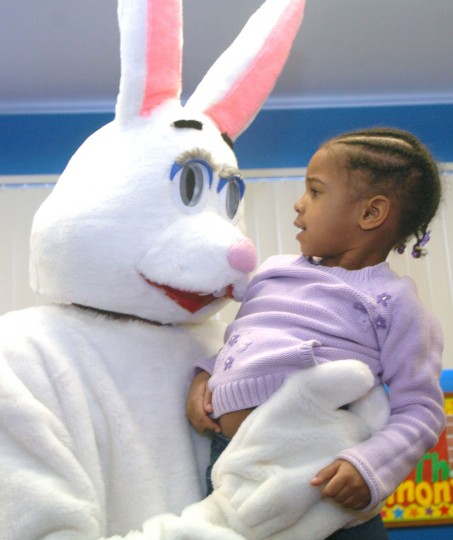 Jayla King, 3, meets the Easter Bunny at the Bywater Boys and Girls Club Easter celebration. (Colleen Dugan/Baltimore Sun Media Group)