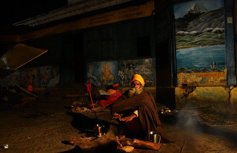 Sadhus - Hindu holy man - sit near the Pashupatinath temple on the eve of the Hindu festival Maha Shivaratri in Kathmandu on March 6, 2016. Hindus mark the Maha Shivratri festival by offering special prayers and fasting.(PRAKASH MATHEMA/AFP/Getty Images)
