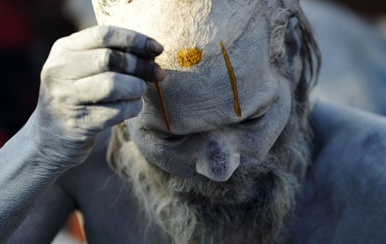 A Nepalese Hindu Sadhu (holy man) paints colored paste onto his face during the Maha Shivaratri festival in Kathmandu on March 7, 2016. Hindus mark the Maha Shivratri festival by offering special prayers and fasting. Hundreds of sadhu have arrived in Kathmandu's Pashupatinath to take part in the Maha Shivaratri festival. (PRAKASH MATHEMA/AFP/Getty Images)