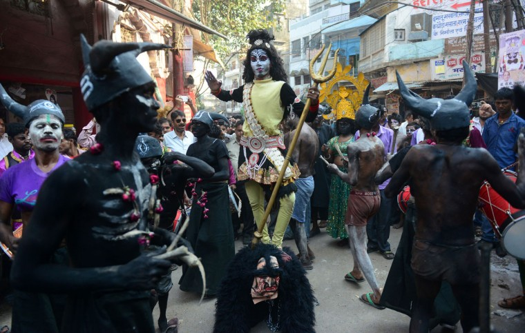 Indian artists dressed as Hindu deities perform during a religious procession to mark the Hindu festival of Maha Shivratri in Allahabad on March 7, 2016. Hindus mark the Maha Shivaratri festival by offering special prayers and fasting to worship the deity Shiva. (SANJAY KANOJIA/AFP/Getty Images)