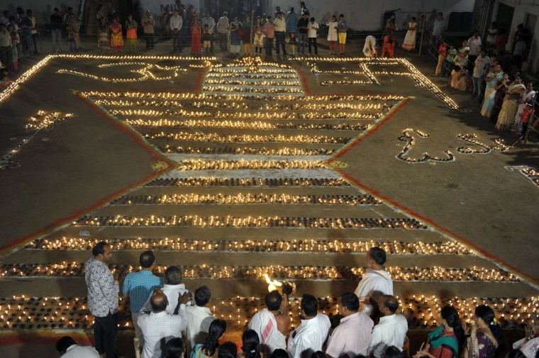 Indian devotees offer prayers after lighting diyas (earthen lamps) in a shape representing Hindu deity Shiva to mark the Maha Shivaratri festival in Hyderabad on March 7, 2016. The festival of Maha Shivaratri is marked by Hindus by fasting and offering prayers in a night-long vigil. (NOAH SEELAM/AFP/Getty Images)