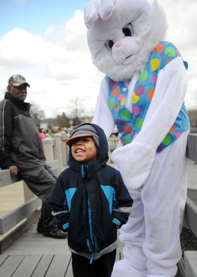 Zion Morris of Abingdon visits the Easter Bunny during the Easter Egg hunt at Annie's playground in Fallston. (Matt Button/Aegis/Baltimore Sun Media Group)