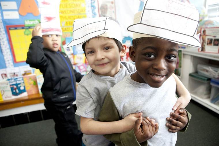 Josue Pina, left, 4, and Keagan Bonsu, right, 4, show off their Dr. Seuss hats during a program in honor of Dr. Seuss's birthday at Head Start Ellicott City in Ellicott City, MD on Wednesday, March 2, 2016.