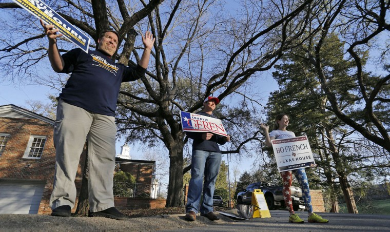 Candidate volunteers greet voters outside of the Westover Hills Town Hall on Super Tuesday, March 1, 2016 in Fort Worth, Texas. (Paul Moseley/Fort Worth Star-Telegram/TNS)