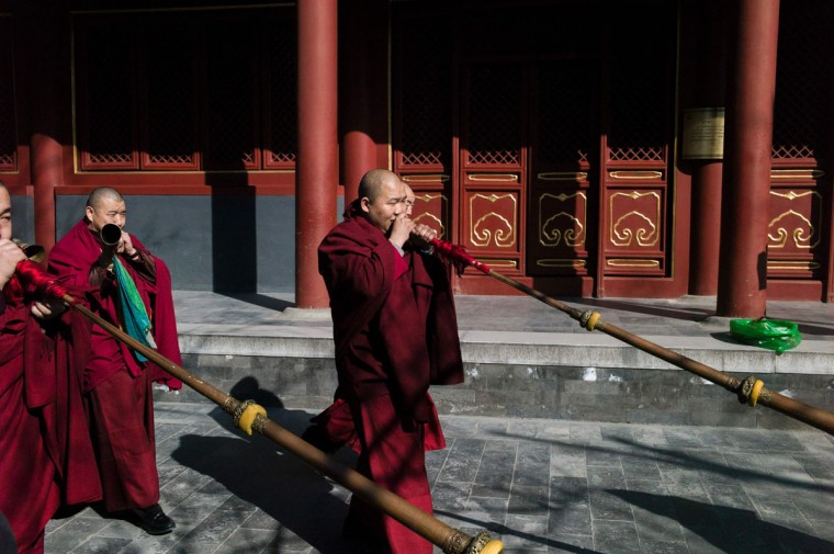 Tibetan monks attend the Beating Ghost festival at the Yonghe Temple, also known as the Lama Temple, in Beijing on March 8, 2016. The Beating Ghost festival, or Da Gui festival in Chinese, is an important ritual of Tibetan Buddhism and is believed to expel evil spirits and shake off troubles. (FRED DUFOUR/AFP/Getty Images)