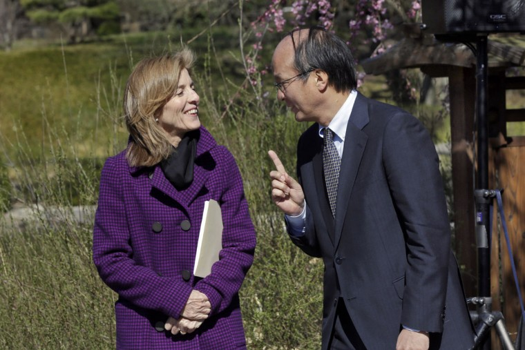 U.S. Ambassador to Japan Caroline Kennedy and Japanese Ambassador and Consul General of Japan in New York Reiichiro Takahashi chat in the Brooklyn Botanical Garden, in New York, March 29, 2016. They participated in ceremonies marking the 100th anniversary year of the Japanese Hill-and-Pond Garden. (AP Photo/Richard Drew)