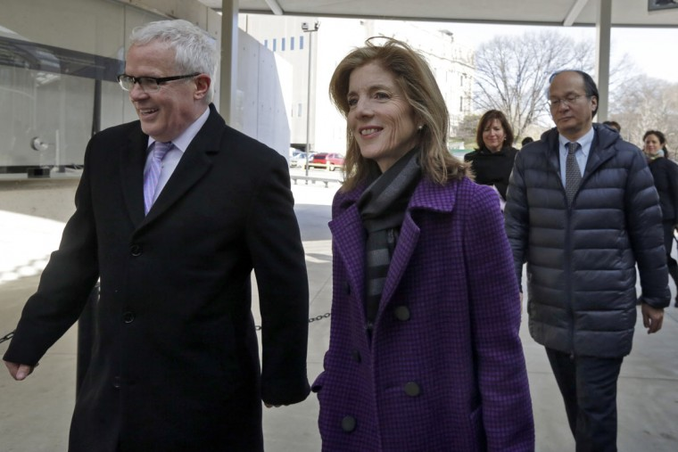 U.S. Ambassador to Japan Caroline Kennedy and Japanese Ambassador and Consul General of Japan in New York Reacher Takahashi, right, are escorted by Brooklyn Botanic Garden President Scot Medbury as they arrive at the venue, in New York, Tuesday, March 29, 2016. They were to participate marking the 100th anniversary year of the Japanese Hill-and-Pond Garden. (AP Photo/Richard Drew)