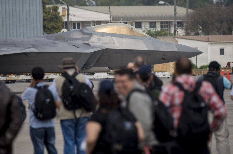 Visitors watch a F22 Raptor during the XIX Air and Space Fair (FIDAE) in Santiago on March 28, 2016. (MARTIN BERNETTI/AFP/Getty Images)