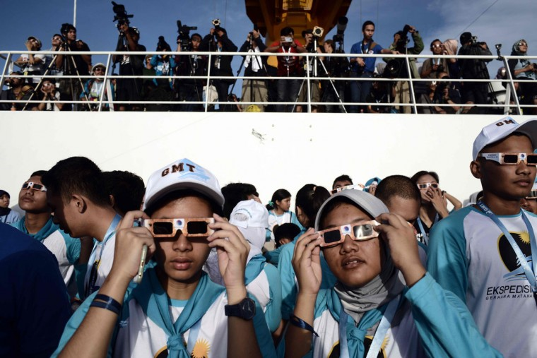 Passengers watch the total solar eclipse onboard the Indonesian cruise ship KM Kelud near the island of Belitung in Indonesia on March 9, 2016. (GOH CHAI HIN/AFP/Getty Images)
