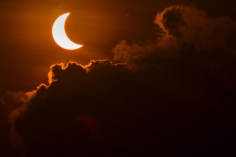 A solar eclipse is pictured from Banda Aceh on March 9, 2016. A total solar eclipse swept across the vast Indonesian archipelago on March 9, witnessed by tens of thousands of sky gazers and marked by parties, Muslim prayers and tribal rituals. (CHAIDEER MAHYUDDIN/AFP/Getty Images)