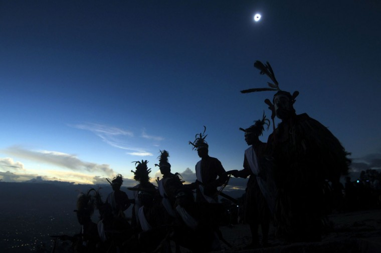 Dancers perform as a solar total eclipse occurs in Matantimali, Central Sulawesi on March 9, 2016. (AFP/Getty Images)