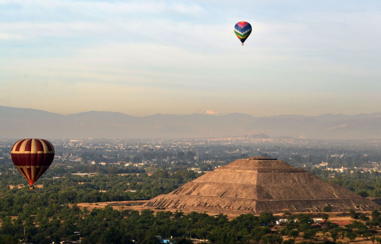 Hot air balloons overly Teotihuacan archaeological site during the Balloon Festival in San Juan de Teotihuacan, State of Mexico, on March 19, 2016. The festival is being held on the spring equinox. (Bernardo Montoya/AFP/Getty Images)