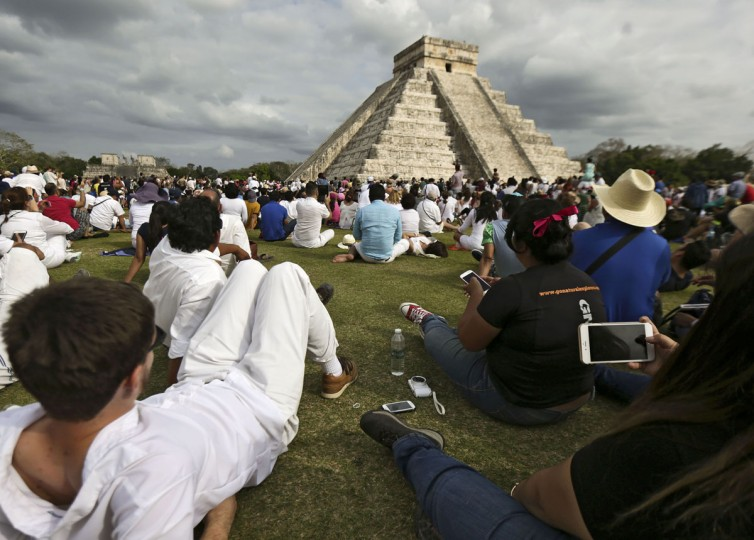 Thousands of tourists surround the Kukulcan Pyramid at the Chichen Itza archeological site during the celebration of the spring equinox in Yucatan state in southeastern Mexico, on March 21, 2016. (ALEJANDRO MEDINA/AFP/Getty Images)