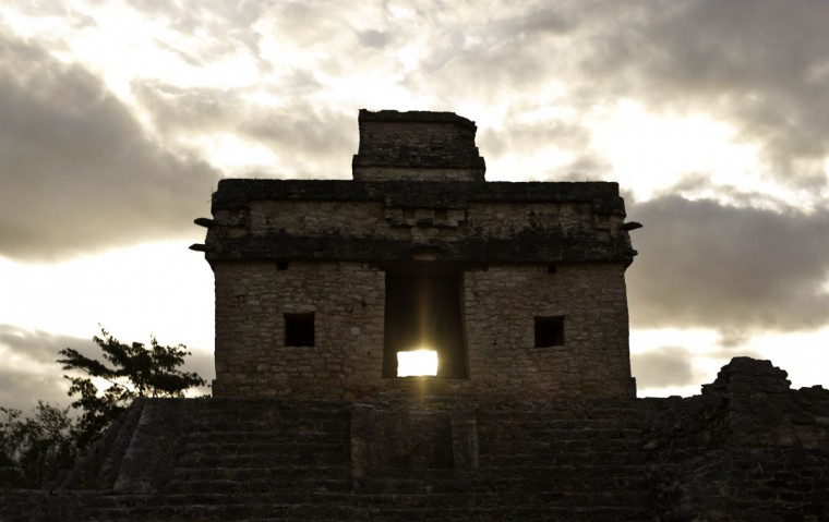 The sun shines directly through the door of the Seven Dolls Temple in the Maya Ruins of Dzibilchaltun, in the Mexican state of Yucatan, as it rises on the spring equinox on March 21, 2016. (ALEJANDRO MEDINA/AFP/Getty Images)