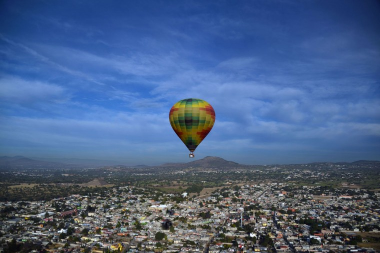 A hot air balloon overlies Teotihuacan archaeological site during the Balloon Festival in San Juan de Teotihuacan, State of Mexico, on March 19, 2016. The festival is being held on the spring equinox. (Bernardo Montoya/AFP/Getty Images)