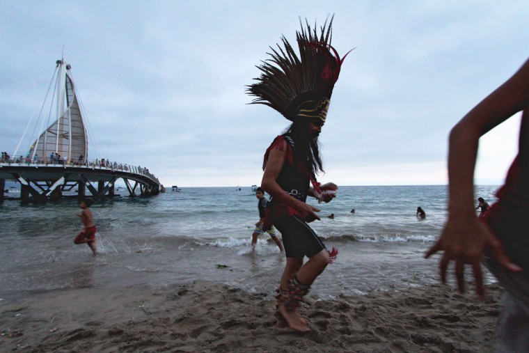 Traditional Mexican dancers perform a pre-Hispanic ritual dance and make offerings to celebrate the spring equinox in Puerto Vallarta, Jalisco state, Mexico on March 21, 2016. (HECTOR GUERRERO/AFP/Getty Images)