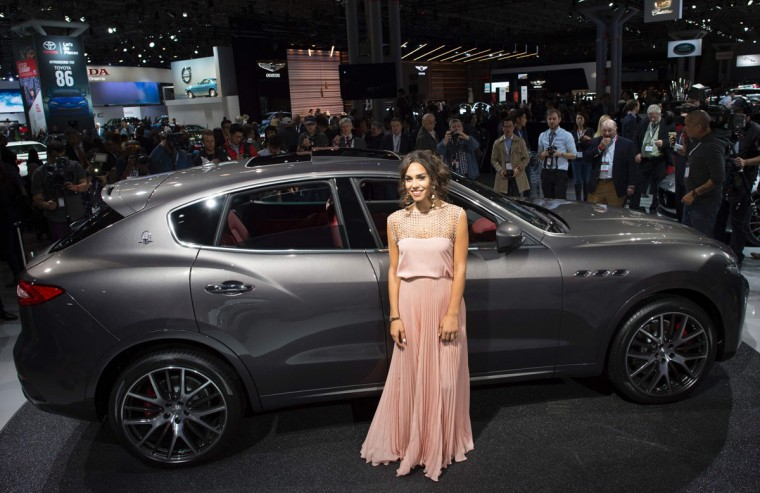 A model poses with the 2017 Mazerati Levante SUV March 23, 2016, at the New York International Auto Show. (DON EMMERT/AFP/Getty Images)