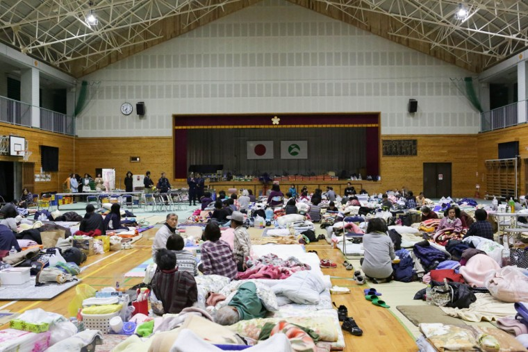 KUMAMOTO, JAPAN - APRIL 17: Local residents who had to evacuate their houses after the earthquake gather at Kawahara elementary school on April 17, 2016 in Nishihara, Kumamoto, Japan. A magnitude-7.3 earthquake hit Kumamoto prefecture on Japan's Kyushu Island on Saturday after one measuring 6.4 struck on Thursday. As of Sunday, reports indicate that 42 people have been killed, 1,500 were injured, and 11 people remain missing. An estimated 80,000 homes are without power and 400,000 homes have no running water. (Photo by Taro Karibe/Getty Images)