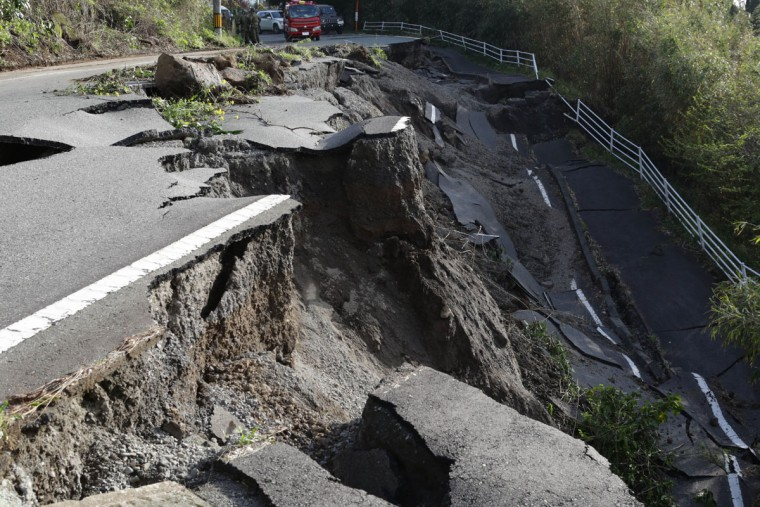 KUMAMOTO, JAPAN - APRIL 17: A road collapse and landslide are seen on April 17, 2016 in Kumamoto, Japan. A magnitude-7.3 earthquake hit Kumamoto prefecture on Japan's Kyushu Island on Saturday after one measuring 6.4 struck on Thursday. As of Sunday, reports indicate that 42 people have been killed, 1,500 were injured, and 11 people remain missing. An estimated 80,000 homes are without power and 400,000 homes have no running water. (Photo by Taro Karibe/Getty Images)