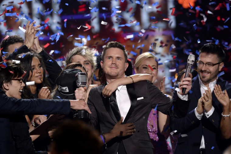 "American Idol Season 15 winner Trent Harmon (C) performs coronation song with Season 15 cast onstage during FOX's ""American Idol"" Finale For The Farewell Season at Dolby Theatre on April 7, 2016 in Hollywood, California. (Photo by Kevork Djansezian/Getty Images)"