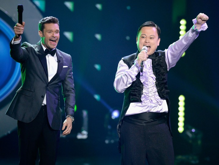 "Host Ryan Seacrest (L) and singer William Hung perform onstage during FOX's ""American Idol"" Finale For The Farewell Season at Dolby Theatre on April 7, 2016 in Hollywood, California. (Photo by Kevork Djansezian/Getty Images)"
