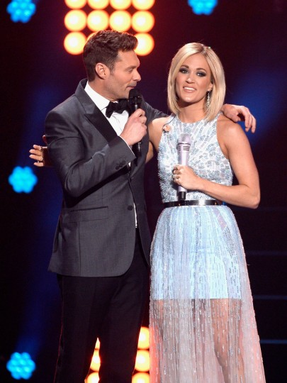 "Host Ryan Seacrest (L) and recording artist Carrie Underwood speak onstage during FOX's ""American Idol"" Finale For The Farewell Season at Dolby Theatre on April 7, 2016 in Hollywood, California. (Photo by Kevork Djansezian/Getty Images)"