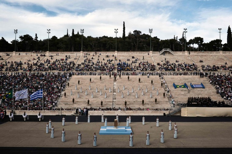 Priestesses perform during the handover ceremony of the Olympic flame, at the Panathinean stadium in Athens, on April 27, 2016. Greece on April 27 handed over to Brazilian officials the Olympic flame of the Rio Games as the 100-day countdown to the August 5 opening ceremony begins. (AFP Photo/Louisa Gouliamaki)