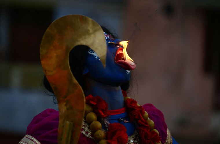 An Indian artist dressed as the Hindu goddess Kali participates in a procession during a Saibaba Palkhi Yatra procession on the occasion of Ram Navami festival in Allahabad on April 15, 2016. Hindu devotees celebrate the festival of Ram Navami, the birth anniversary of Lord Rama, across India, which also marks the end of the nine-day long fasting and Navaratri festival. (Sanjay Kanojia/AFP/Getty Images)