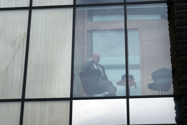 REYKJAVIK, ICELAND: REYKJAVIK, ICELAND: A man looks out from the Parliament building following the government shake-up in the wake of the Panama Papers crisis on April 5, 2016 in Reykjavik, Iceland. Prime Minister Sigmundur David Gunnlaugsson has resigned after news broke on Sunday that he had hid his assets in an offshore shell-company whose existence was revealed by the Panama Papers. Numerous leaders around the world as well as wealthy individuals have been caught-up in the developing scandal. (Photo by Spencer Platt/Getty Images)