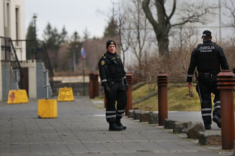 REYKJAVIK, ICELAND - APRIL 05: Police stand outside of the Parliament building following the government shake-up in the wake of the Panama Papers crisis on April 5, 2016 in Reykjavik, Iceland. Prime Minister Sigmundur David Gunnlaugsson has resigned after news broke on Sunday that he had hid his assets in an offshore shell-company whose existence was revealed by the Panama Papers. Numerous leaders around the world as well as wealthy individuals have been caught-up in the developing scandal. (Photo by Spencer Platt/Getty Images)