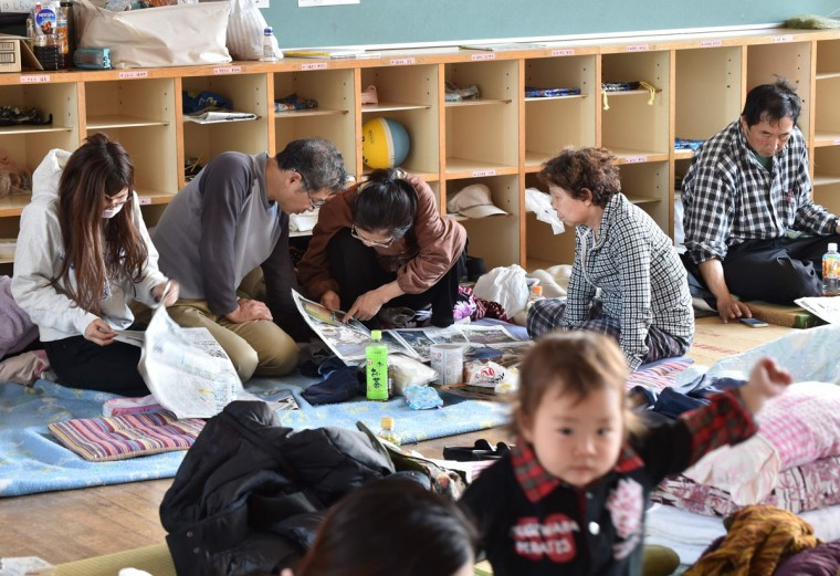 Japanese evacuees rest at an elementary school in the village of Nishihara, in Kumamoto prefecture on April 17, 2016. Rescuers were racing against the weather and the threat of more landslides April 17 to reach people still trapped by two big earthquakes that hit southern Japan. / AFP PHOTO / KAZUHIRO NOGIKAZUHIRO NOGI/AFP/Getty Images
