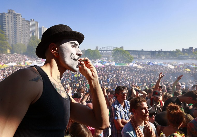 A 4/20 participant sports a painted face as he smokes marijuana at 4:20pm as thousands of people gathered four 4/20 celebrations on April 20, 2016 at Sunset Beach in Vancouver, Canada. The Vancouver 4/20 event is the largest free protest festival in the city, with day-long music, public speakers and the world's only open-air public cannabis farmer's market where people sell all kinds of cannabis and extracts while educating the crowd about medical marijuana, political involvement and activism. Canadian Federal Health Minister Jane Philpott says Canada will roll out the legislation in the spring of 2017 to begin the process of legalizing and regulating marijuana. (Photo by Jeff Vinnick/Getty Images)