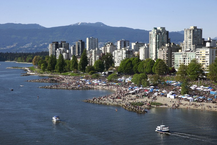 Thousands of people gather at 4/20 celebrations on April 20, 2016 at Sunset Beach in Vancouver, Canada. The Vancouver 4/20 event is the largest free protest festival in the city, with day-long music, public speakers and the world's only open-air public cannabis farmer's market where people sell all kinds of cannabis and extracts while educating the crowd about medical marijuana, political involvement and activism. Canadian Federal Health Minister Jane Philpott says Canada will roll out the legislation in the spring of 2017 to begin the process of legalizing and regulating marijuana. (Photo by Jeff Vinnick/Getty Images)