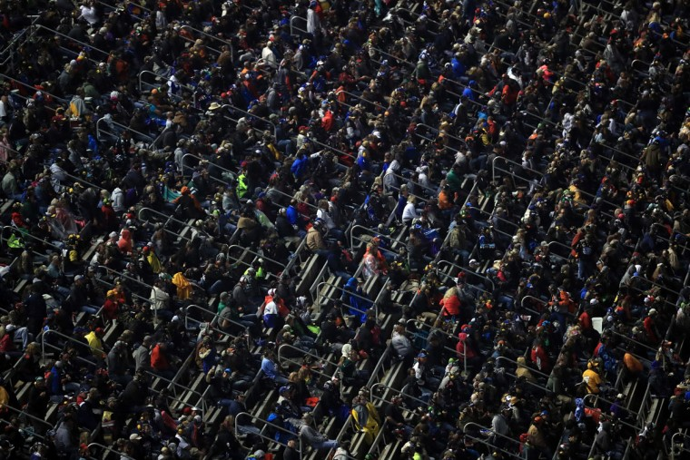 FORT WORTH, TEXAS - APRIL 09: Fans look on during the NASCAR Sprint Cup Series Duck Commander 500 at Texas Motor Speedway on April 9, 2016 in Fort Worth, Texas. (Photo by Tom Pennington/Getty Images)