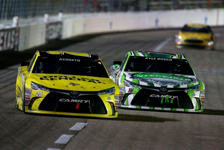 FORT WORTH, TEXAS - APRIL 09: Matt Kenseth, driver of the #20 Dollar General Toyota, leads Kyle Busch, driver of the #18 Interstate Batteries Toyota, during the NASCAR Sprint Cup Series Duck Commander 500 at Texas Motor Speedway on April 9, 2016 in Fort Worth, Texas. (Photo by Sarah Crabill/Getty Images for Texas Motor Speedway)