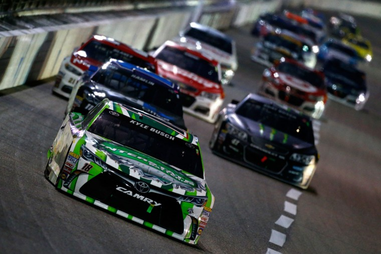 FORT WORTH, TEXAS - APRIL 09: Kyle Busch, driver of the #18 Interstate Batteries Toyota, leads a pack of cars during the NASCAR Sprint Cup Series Duck Commander 500 at Texas Motor Speedway on April 9, 2016 in Fort Worth, Texas. (Photo by Jonathan Ferrey/Getty Images for Texas Motor Speedway)