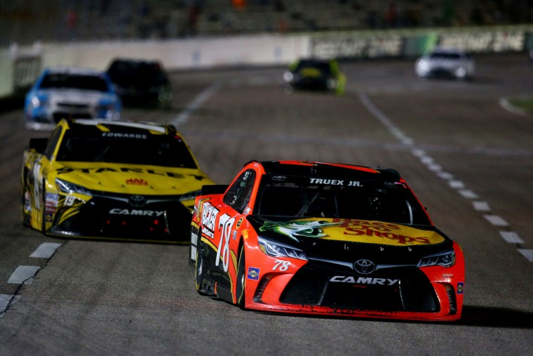 FORT WORTH, TEXAS - APRIL 09: Martin Truex Jr., driver of the #78 Bass Pro Shops/TRACKER Boats Toyota, leads a pack of cars during the NASCAR Sprint Cup Series Duck Commander 500 at Texas Motor Speedway on April 9, 2016 in Fort Worth, Texas. (Photo by Sarah Crabill/Getty Images for Texas Motor Speedway)