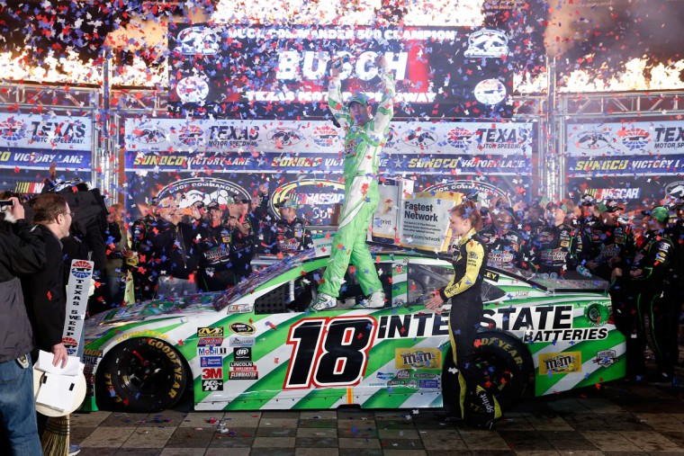 FORT WORTH, TEXAS - APRIL 09: Kyle Busch, driver of the #18 Interstate Batteries Toyota, celebrates after winning the NASCAR Sprint Cup Series Duck Commander 500 at Texas Motor Speedway on April 9, 2016 in Fort Worth, Texas. (Photo by Brian Lawdermilk/Getty Images)
