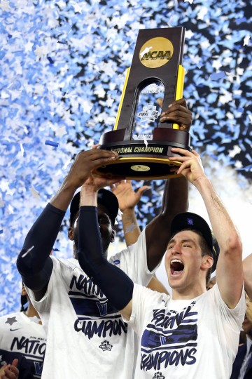 Daniel Ochefu #23 of the Villanova Wildcats (L) and Ryan Arcidiacono #15 (R) hoist the trophy after the Villanova Wildcats defeat the North Carolina Tar Heels 77-74 to win the 2016 NCAA Men's Final Four National Championship game at NRG Stadium on April 4, 2016 in Houston, Texas. (Photo by Streeter Lecka/Getty Images)