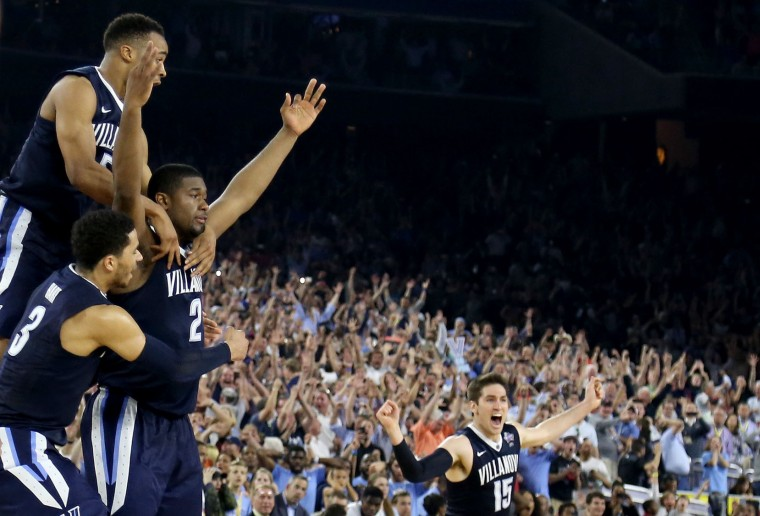 Kris Jenkins #2 of the Villanova Wildcats celebrates with teammates after making the game-winning three pointer to defeat the North Carolina Tar Heels 77-74 in the 2016 NCAA Men's Final Four National Championship game at NRG Stadium on April 4, 2016 in Houston, Texas. (Photo by Streeter Lecka/Getty Images)