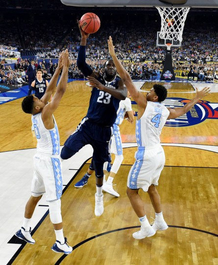 Daniel Ochefu #23 of the Villanova Wildcats shoots the ball against the North Carolina Tar Heels during the 2016 NCAA Men's Final Four National Championship game at NRG Stadium on April 4, 2016 in Houston, Texas. (Photo by Pool - Robert Deutsch/Getty Images)